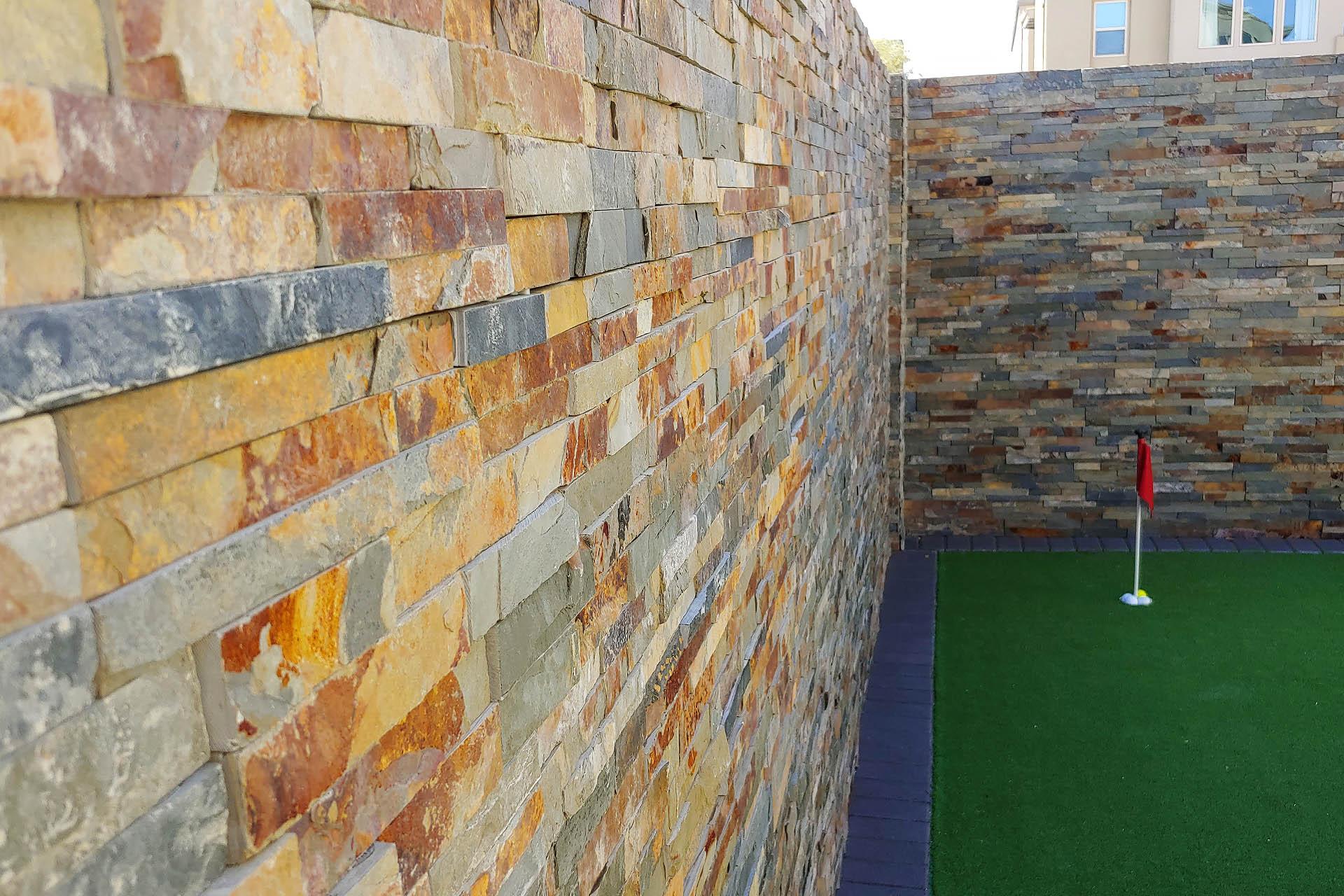 View Back Yard Stone Veneer Installation