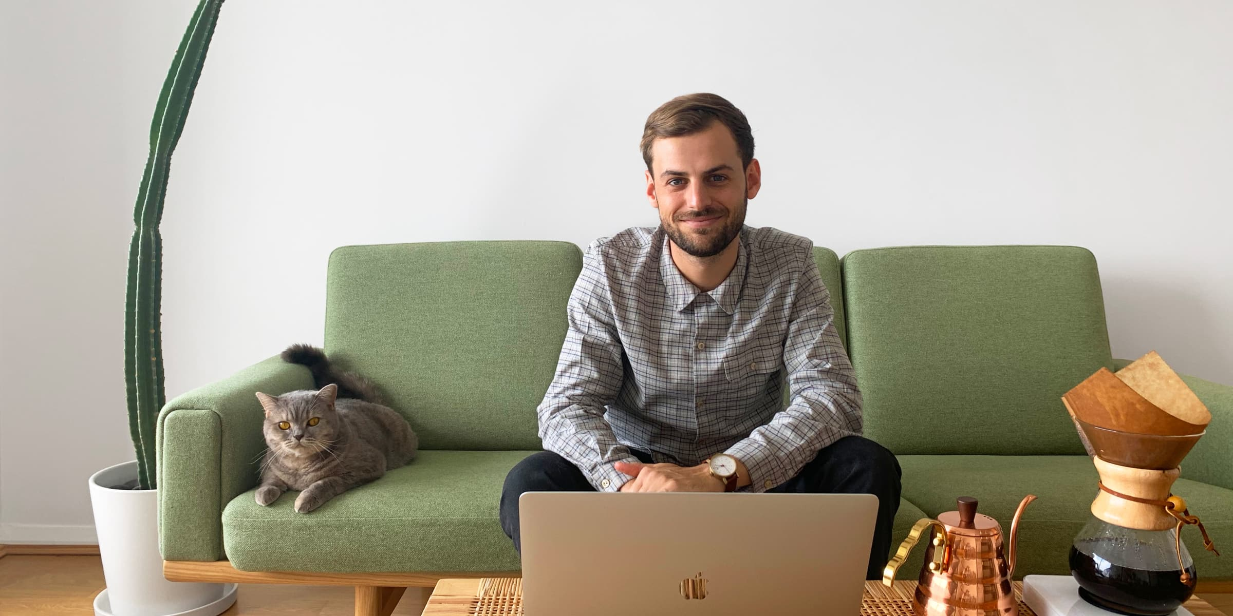 Product UX/UI Designer, Jordan Hughes, sitting on couch