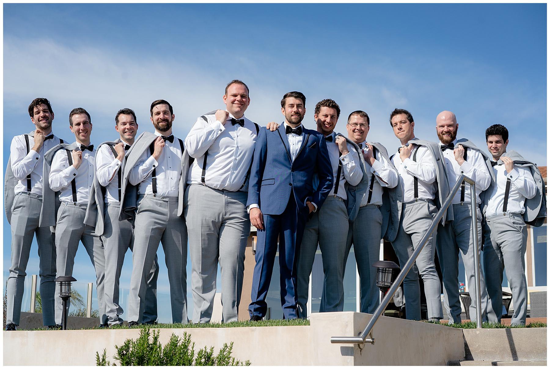 groomsmen photo jackets over shoulder