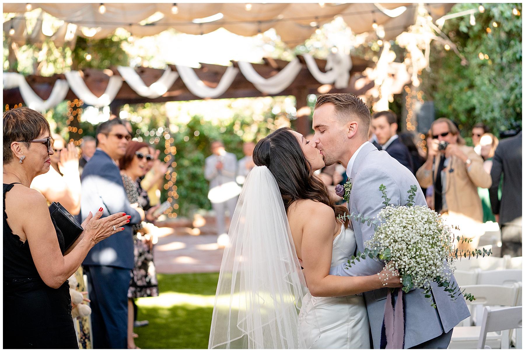 bride and groom kiss calamigos equestrian center wedding