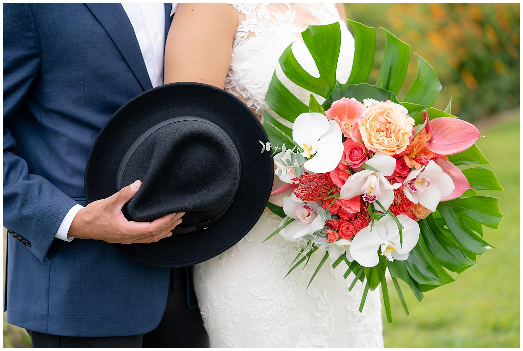 grooms top hat tropical bouquet