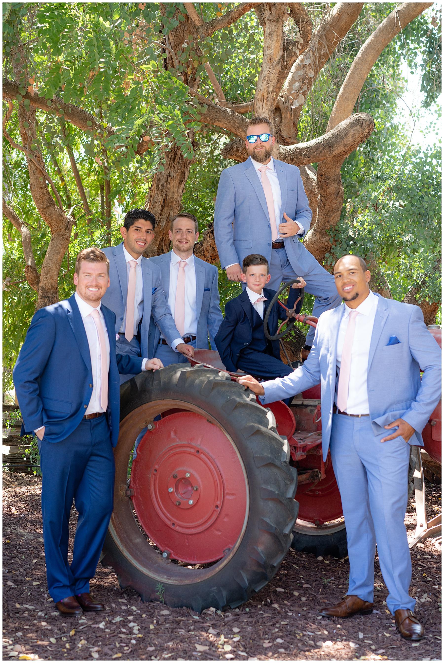 groomsmen on a tractor temecula wedding
