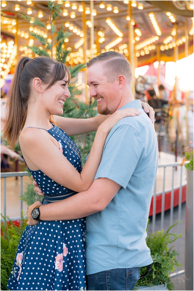 engagement photo on a carousel