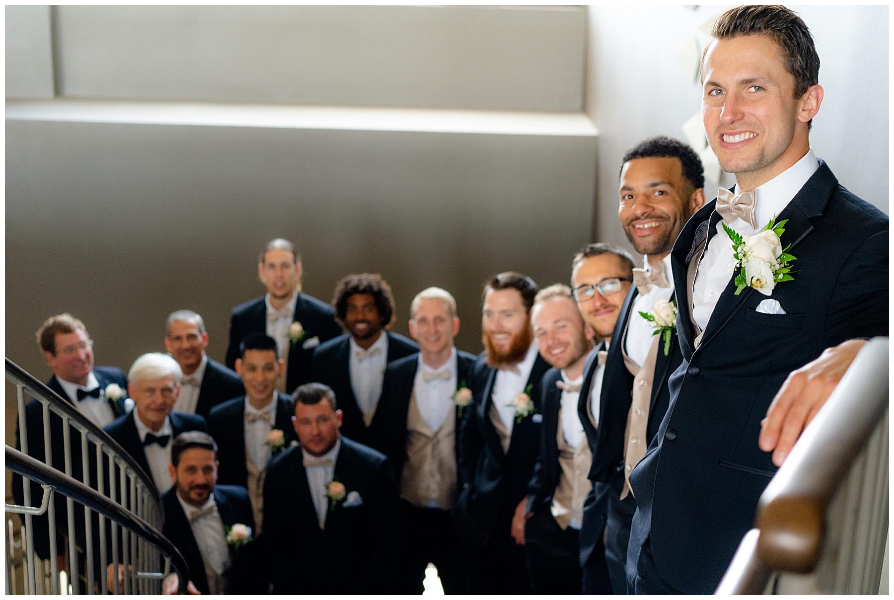 groomsmen photo down stairs
