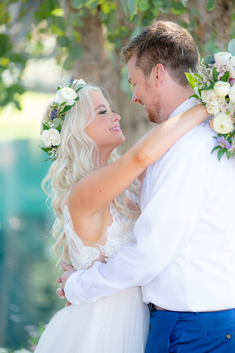 bride's flower crown lake wedding