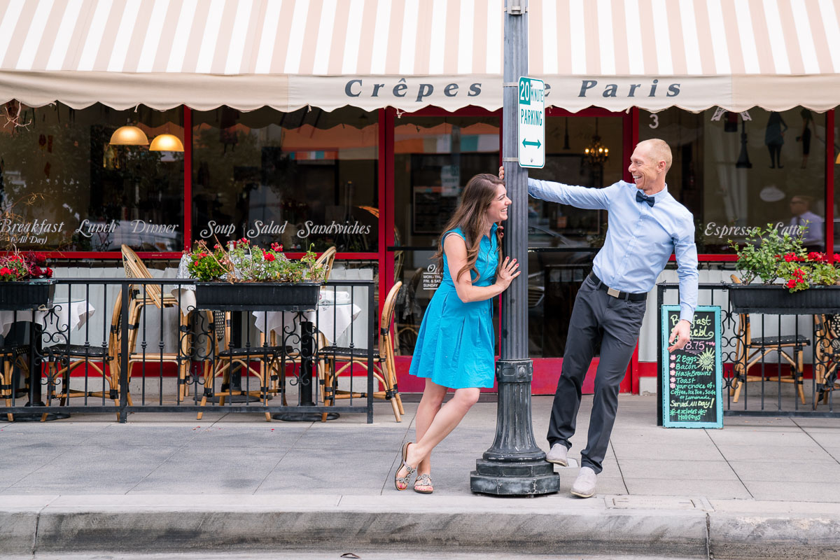 fun engagement location idea in front of a cafe
