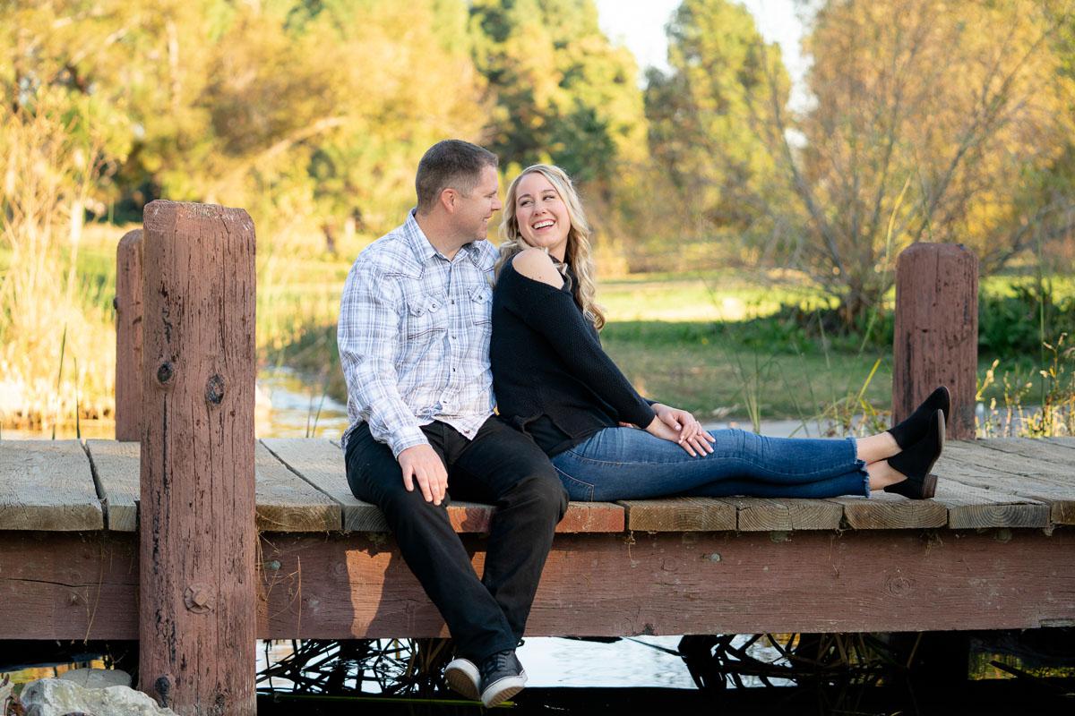 el dorado park engagement couple on a bridge