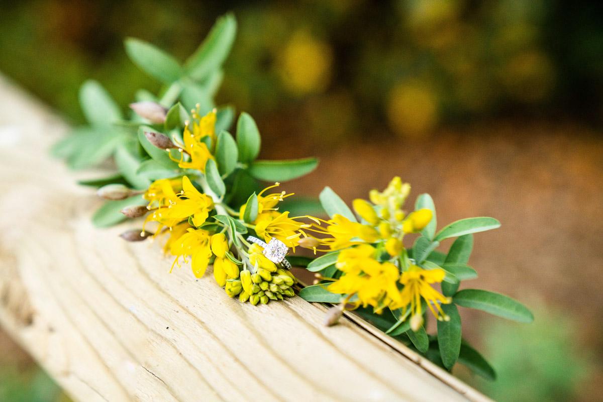 wedding ring on yellow flowers