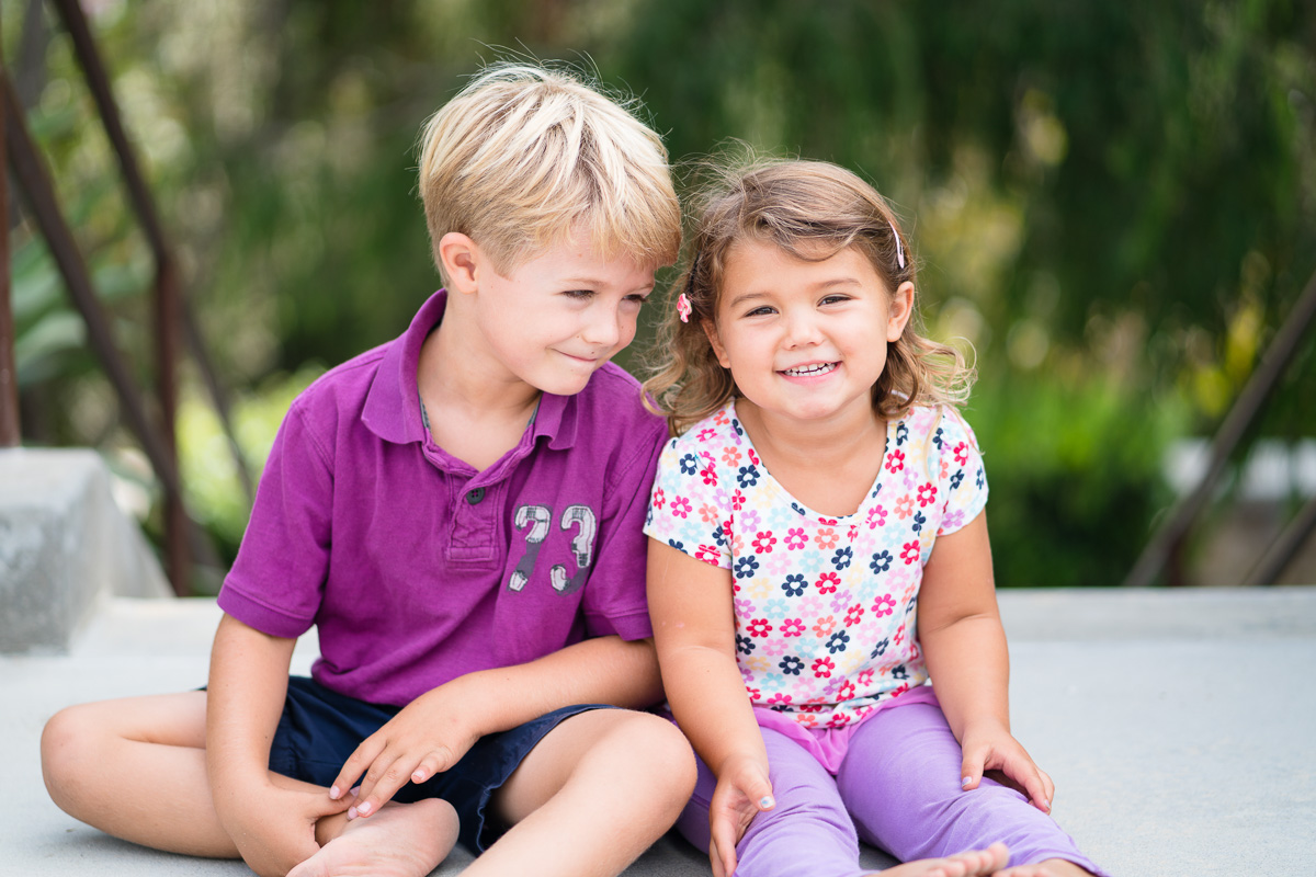brother and sister wearing purple