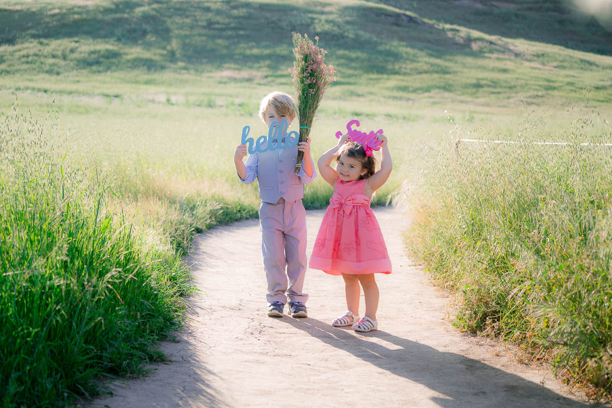 little boy and girl on path