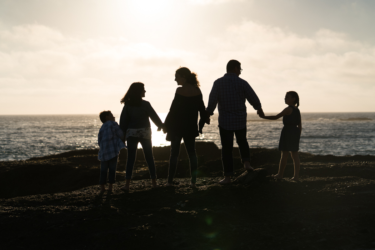 family silhouette on beach