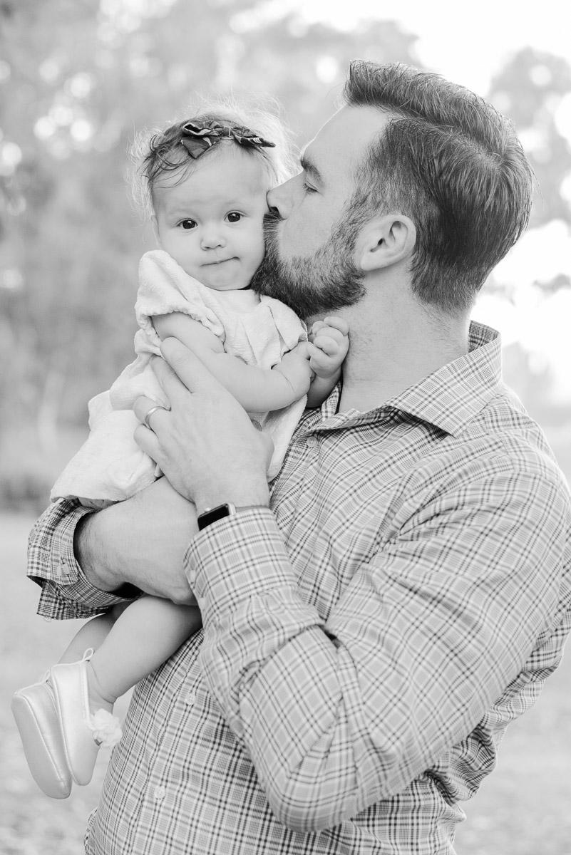 dad kisses son