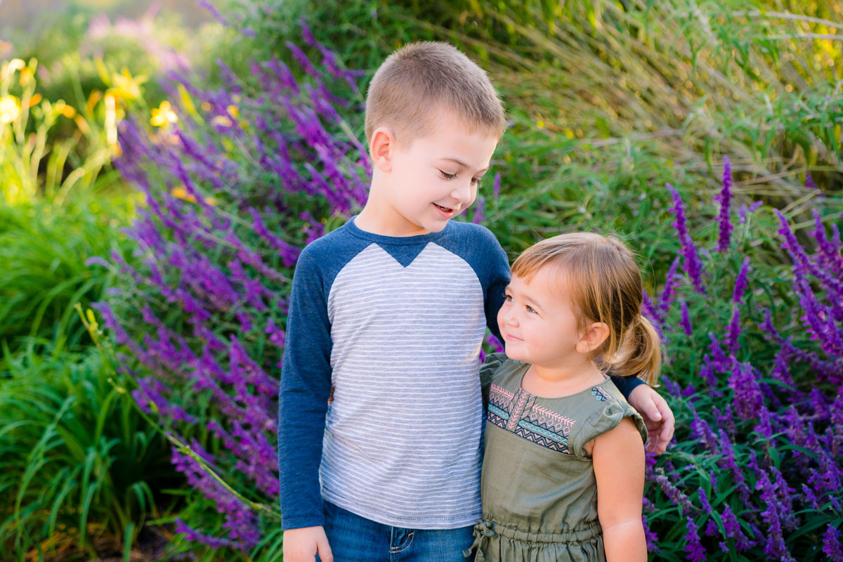 purple flowers and two kids