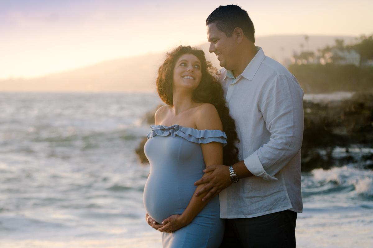 sunset maternity photo tight blue dress