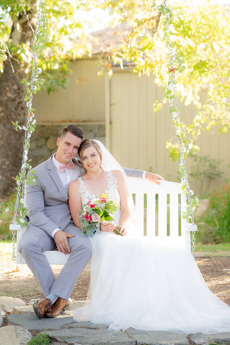 wedding portrait on a porch swing