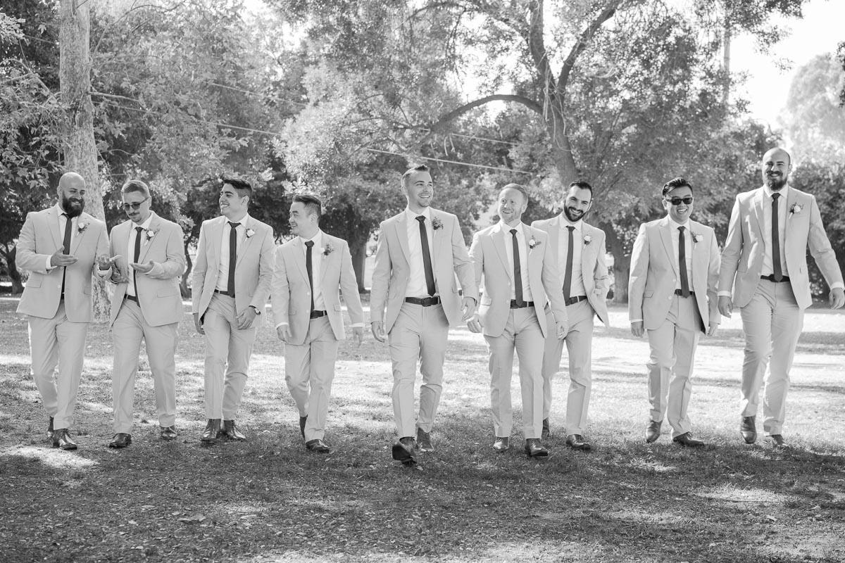 groomsmen walking photo black and white
