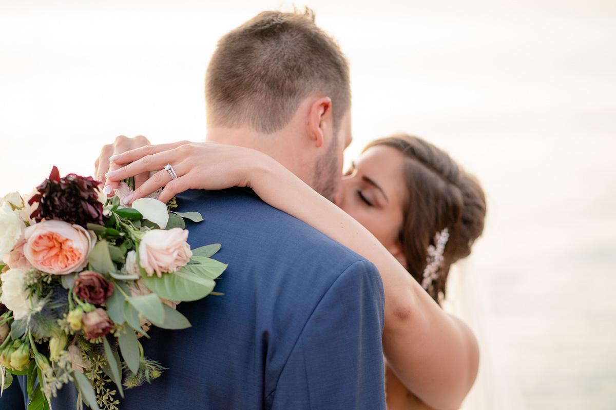 sunset cliffs wedding kiss