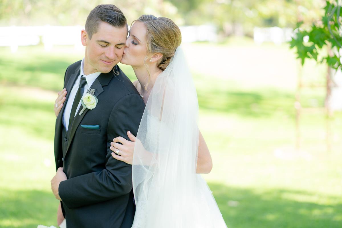 wedding day portrait kissing