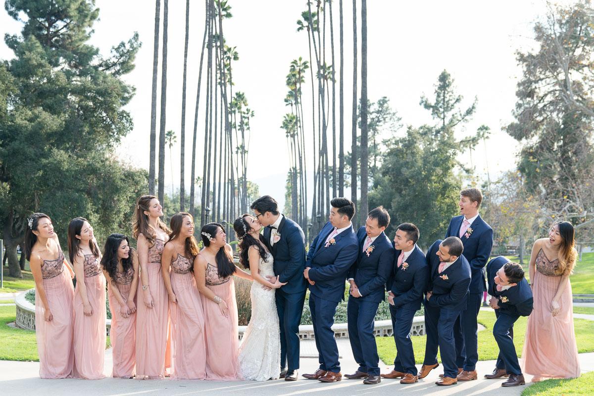 pink wedding party fun group photo