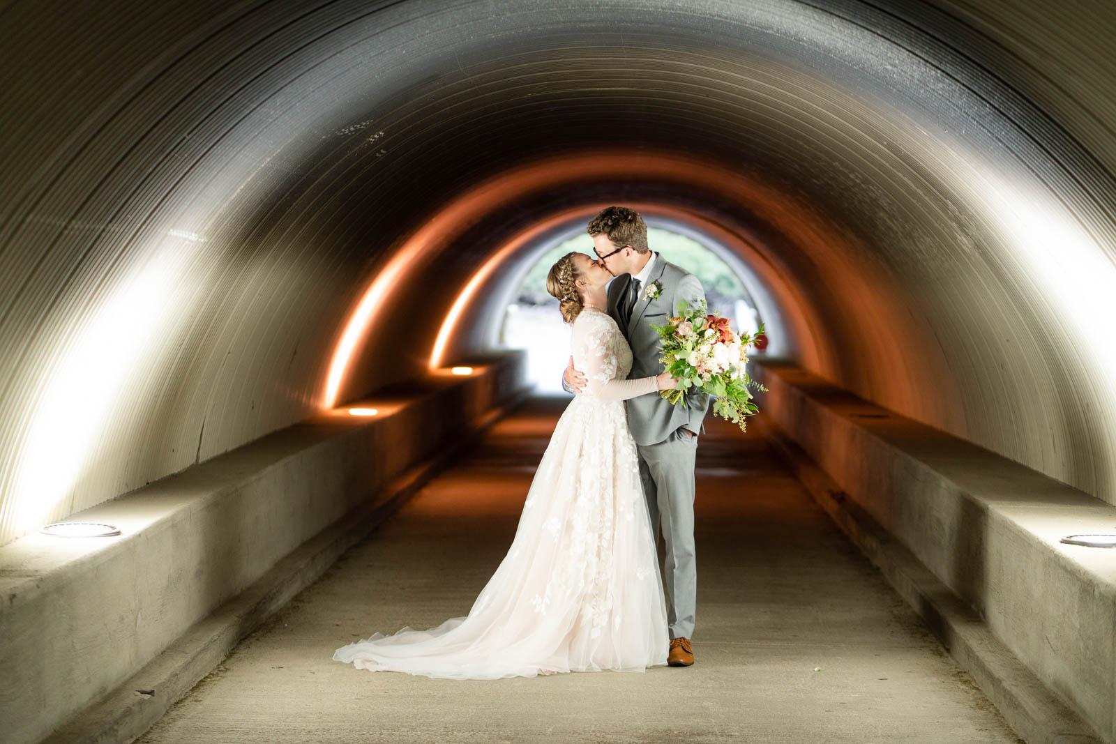 couple kissing in talega golf club tunnel