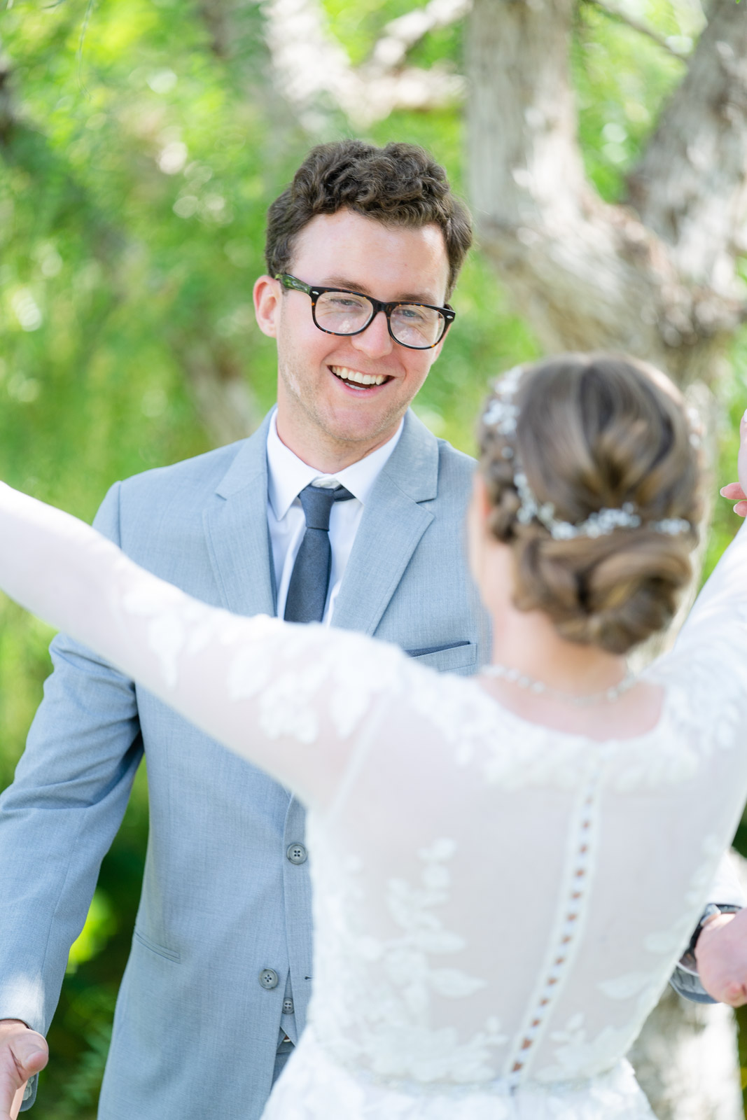 first look grooms reaction