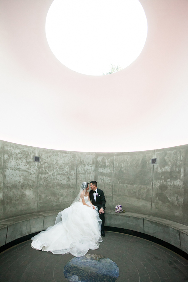 Bride and groom gazing into each other's eyes at de Young Museum in San Francisco