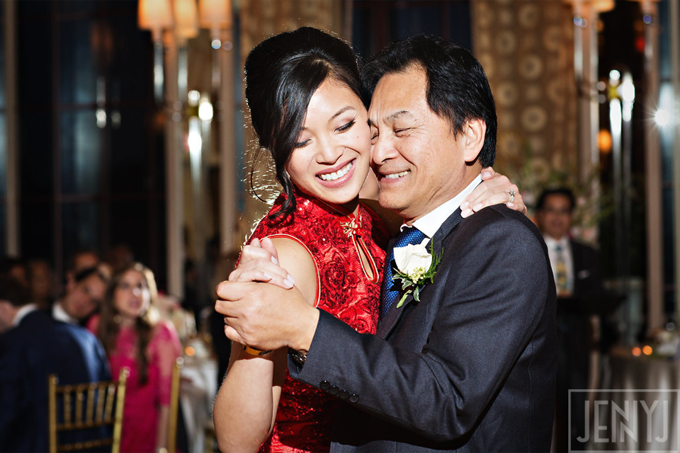 Bride wearing qipao dances with father