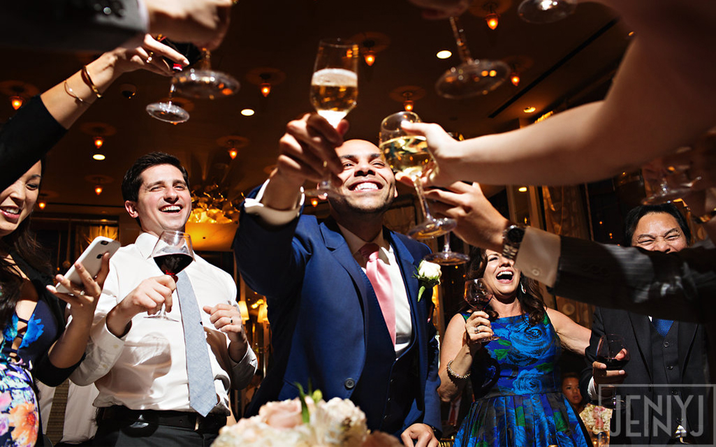 Groom toasting champagne with guests