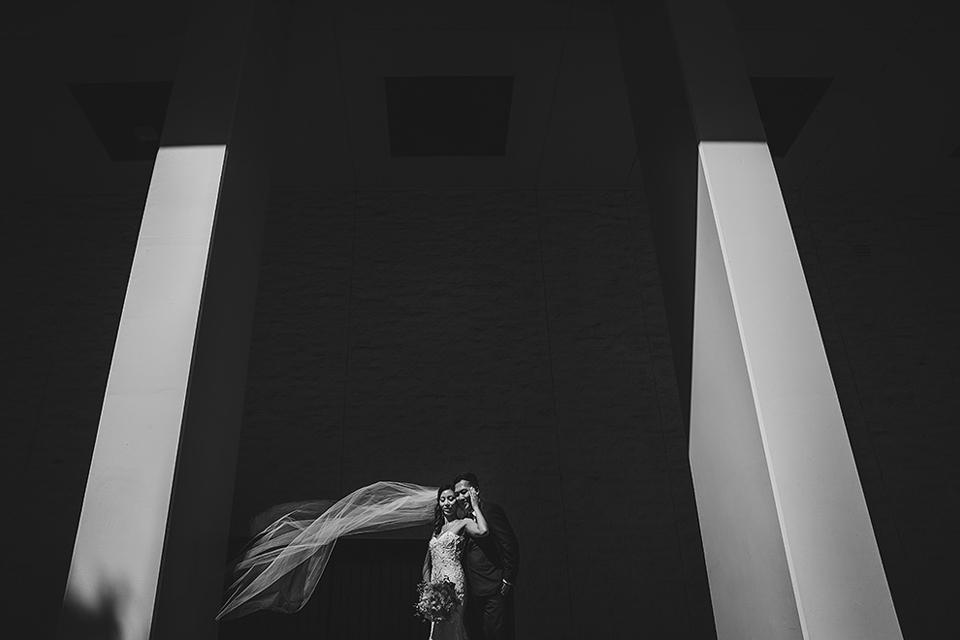 Bride and groom between columns