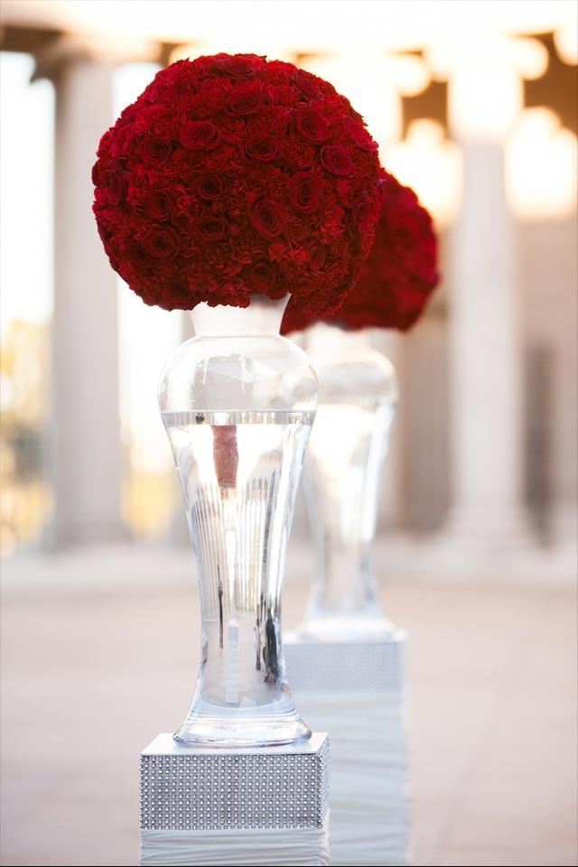 Wedding floral arrangement of red flower kissing balls