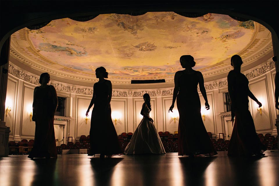 Silhouettes of bride and bridesmaids in the John A. and Cynthia Fry Gunn Theater at the Legion of Honor in San Francisco
