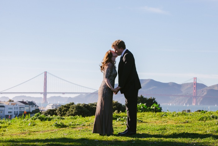 Wedding couple kissing at Crissy Fields overlooking the Golden Gate Bridge in San Francisco