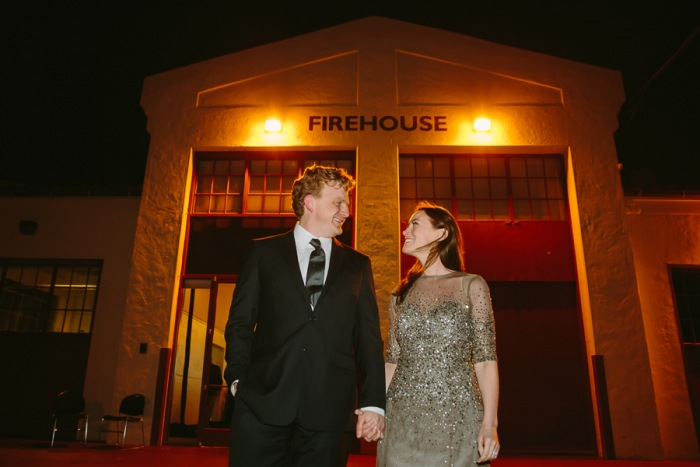 Bride and groom looking at each other in front of The Firehouse at Fort Mason in San Francisco