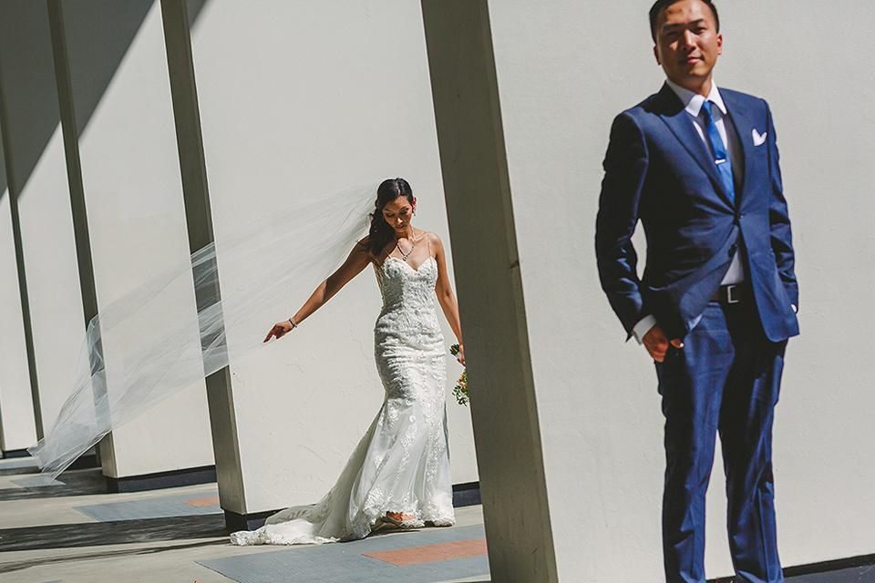 Bride and groom standing by columns