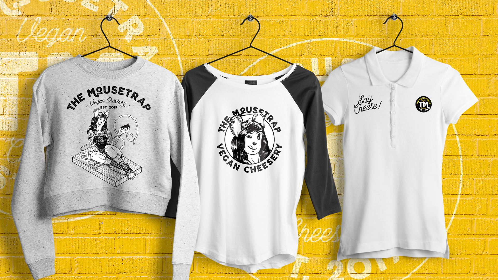 The Mousetrap pinup and logo used on different pieces of apparel