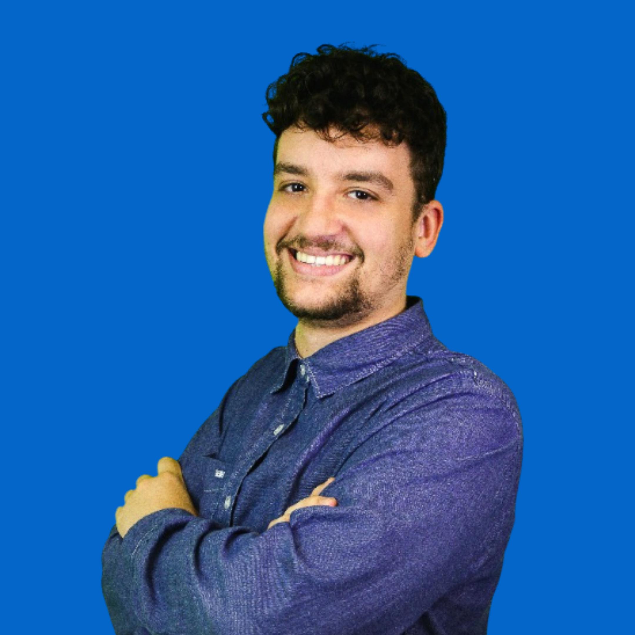 man in blue shirt smiling