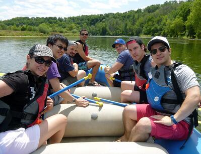 Fuller Landau LLP employees on their way to ride the rapids during an offsite summer event.