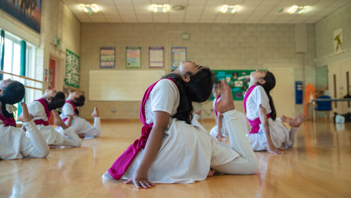 flexible chitraleka dance academy students in class stretching