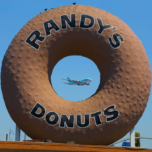 Airbus A380 behind the Randy's Donuts sign