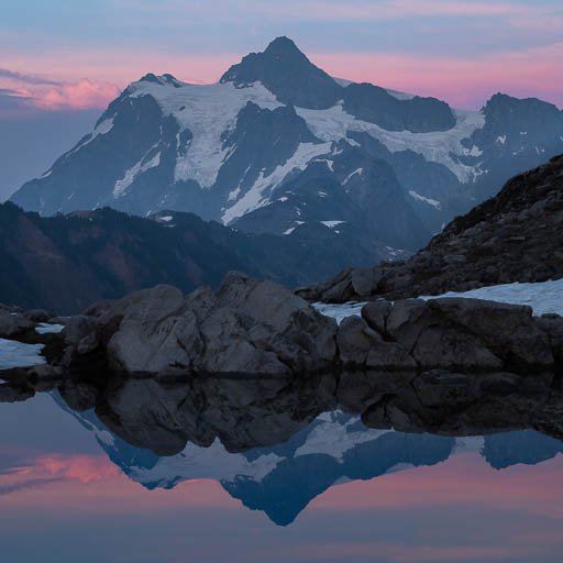 Mount Shuksan mirrored on a pond at sunset