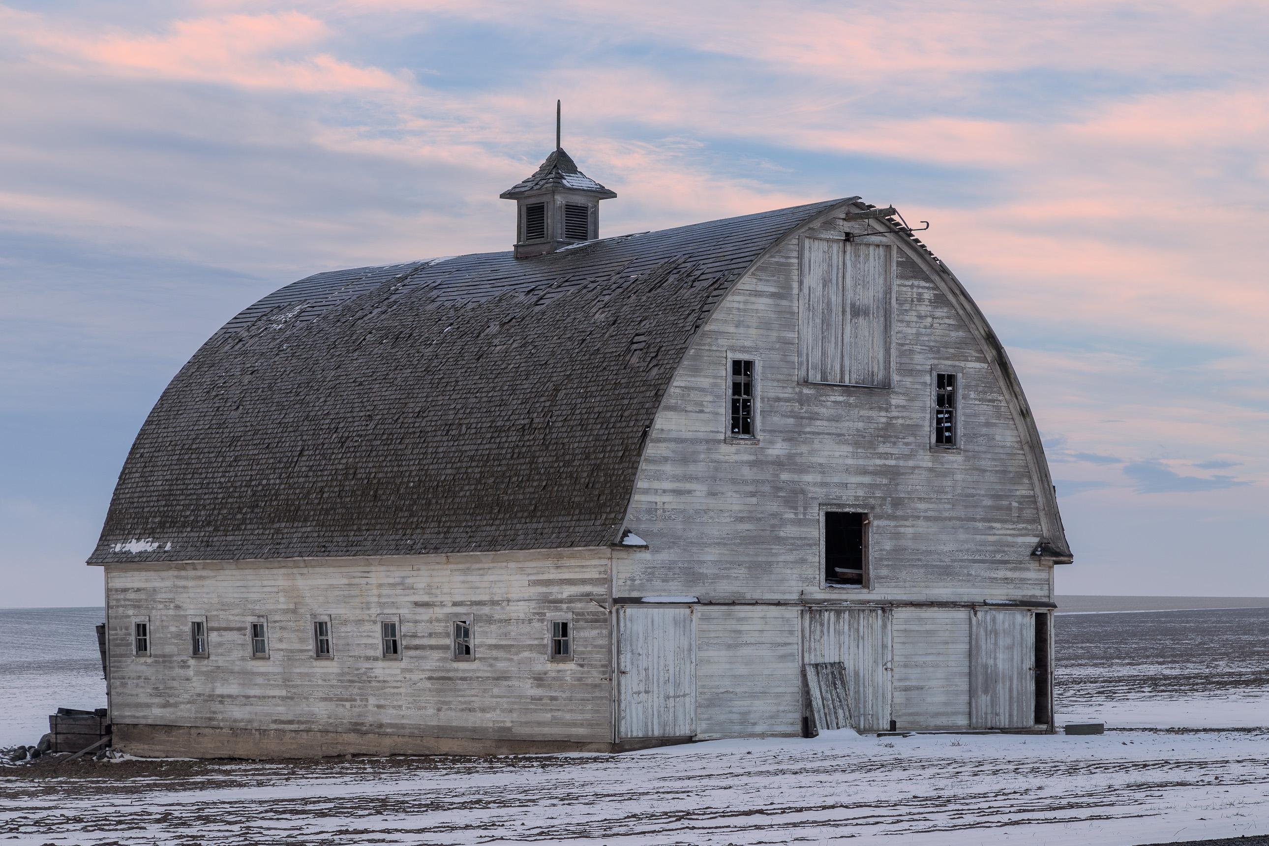 Abandoned white barn