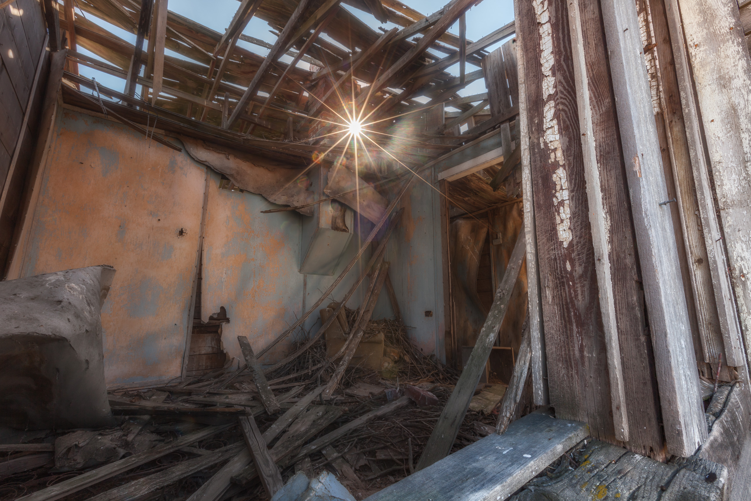 Sunburst through the roof of an abandoned house