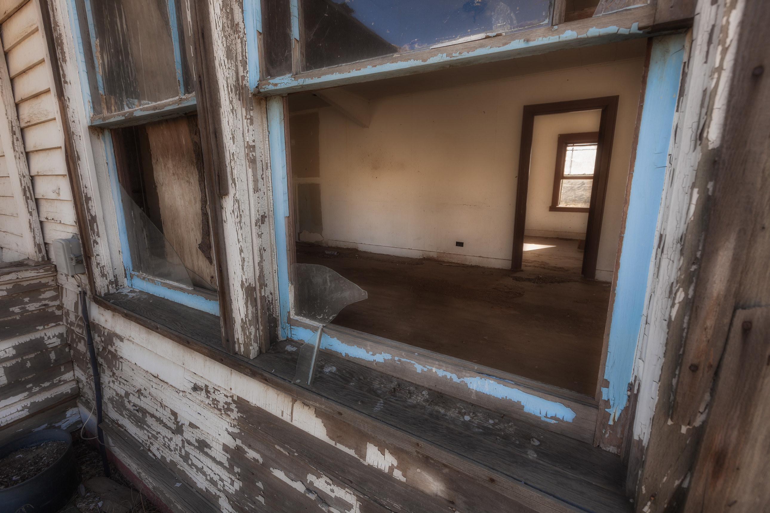 Looking Through Windows of an Abandoned House in Washington