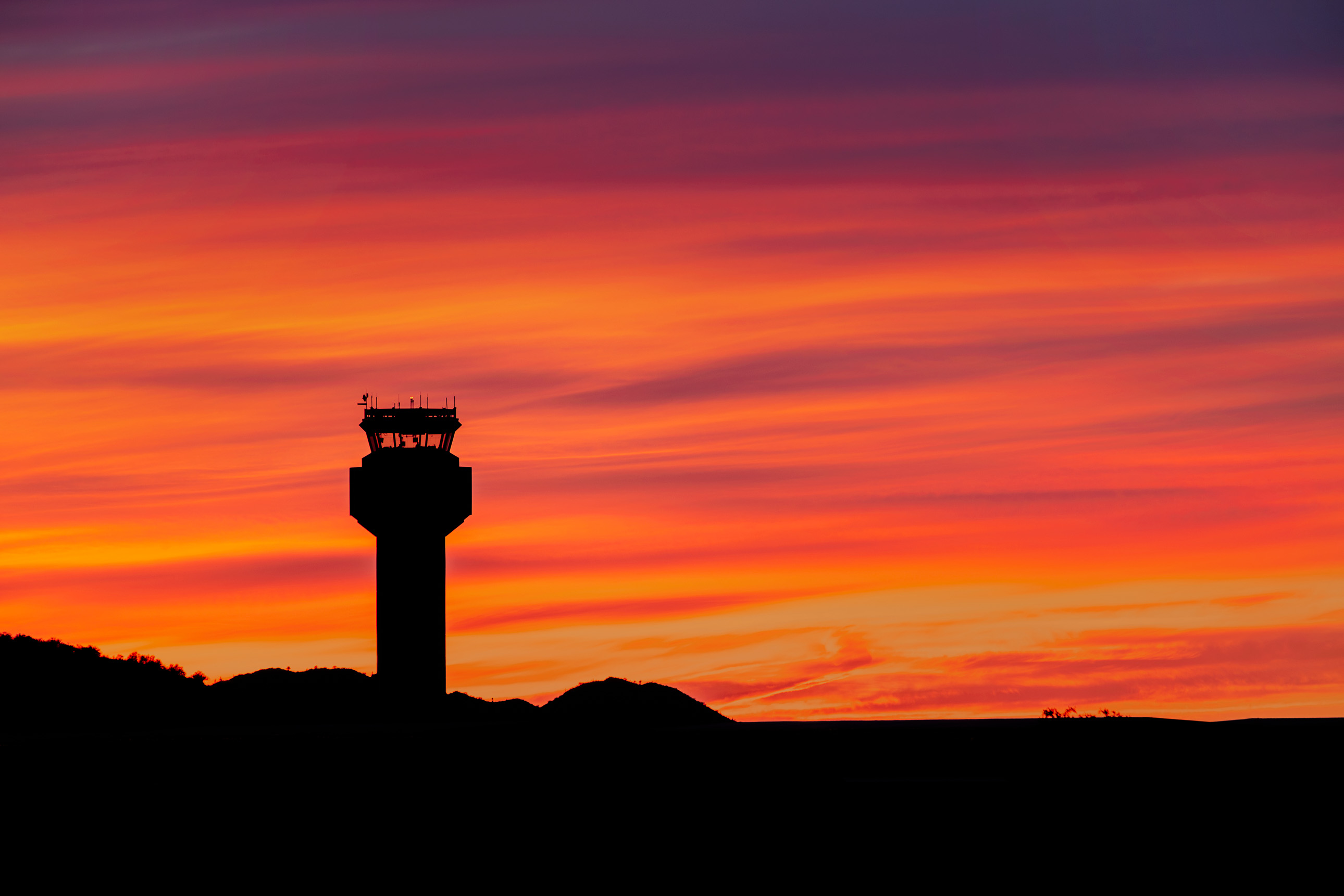 Beautiful vibrant sunset with Deer Valley Airport's tower in the foreground