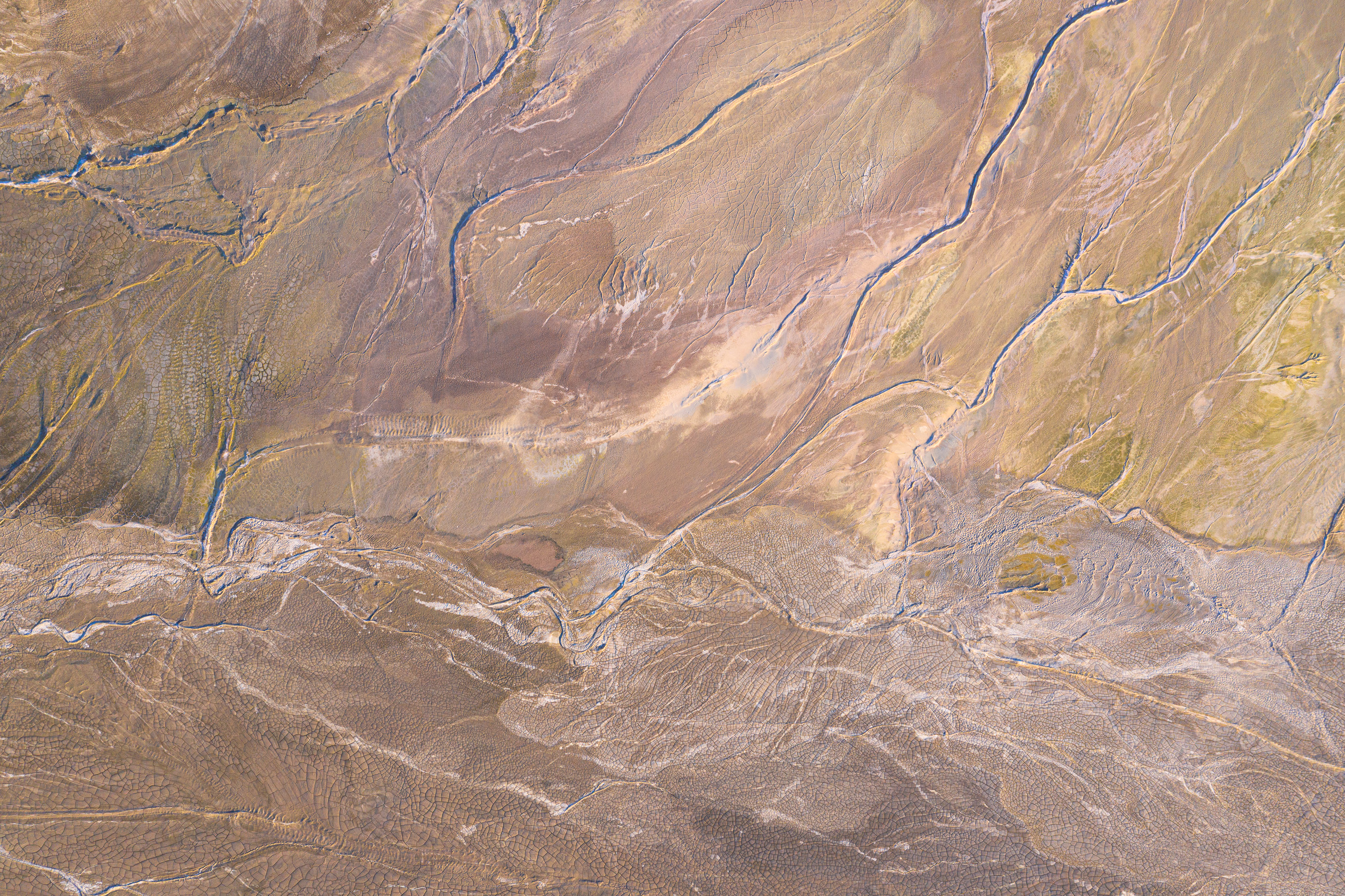 Photograph of a colorful tailings reservoir from a drone