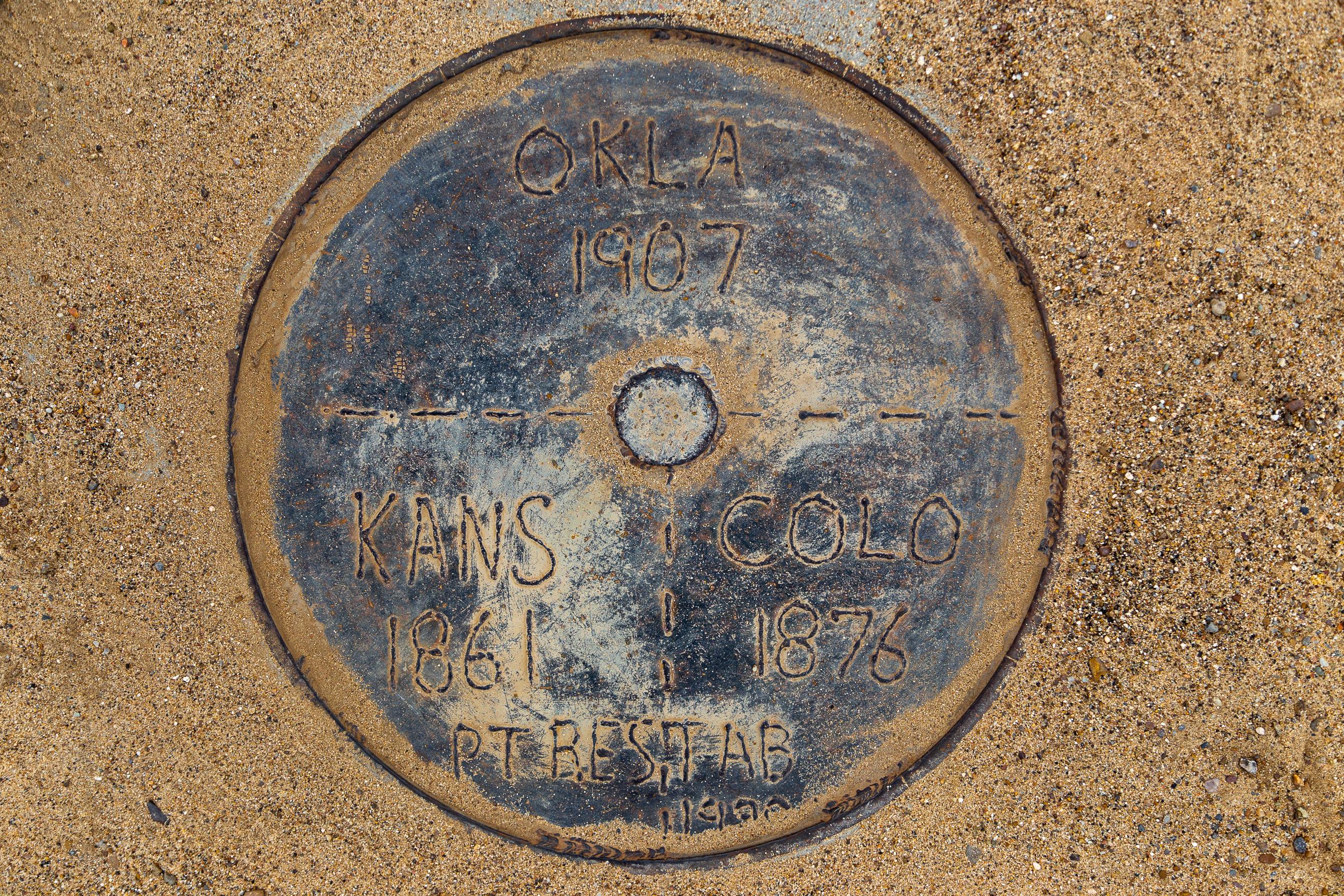 Tripoint marker where Kansas, Oklahoma and Colorado meet