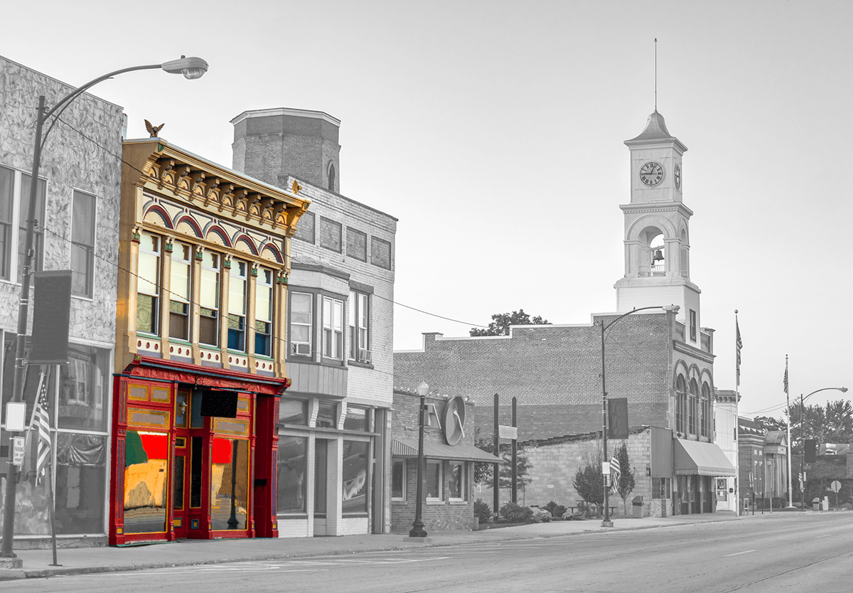 Storefronts on empty main street in small town USA