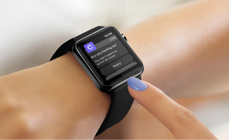 Woman pointing to apple watch
