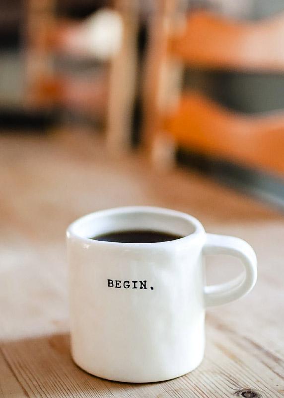 "A coffee mug that says ""Begin."""