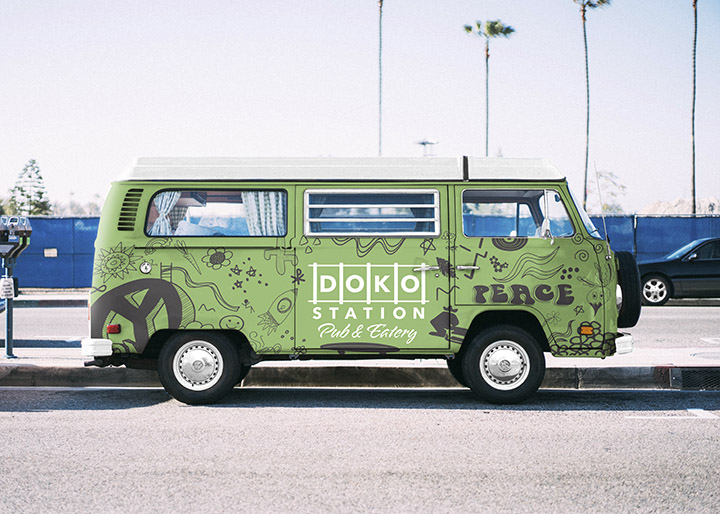 A green VW bus with the Doko Station logo and custom graffiti.